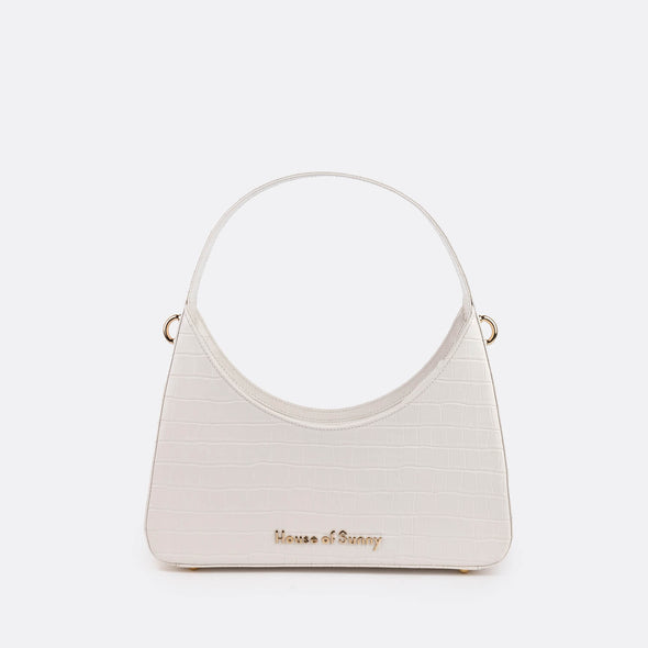 White retro shoulder bag in oversized croc effect vegan leather.