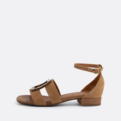 Brown suede flat sandals with thin straps connected by a buckle.