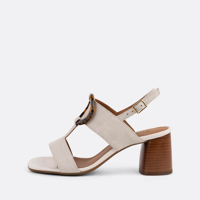 White suede slingback heeled sandals featuring acrylic appliques.