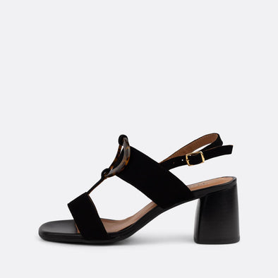 Black suede slingback heeled sandals featuring acrylic appliques.