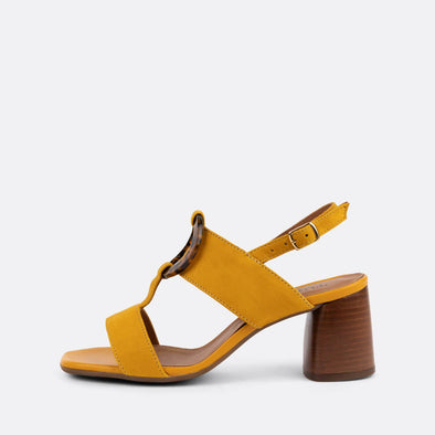 Yellow suede slingback heeled sandals featuring acrylic appliques.