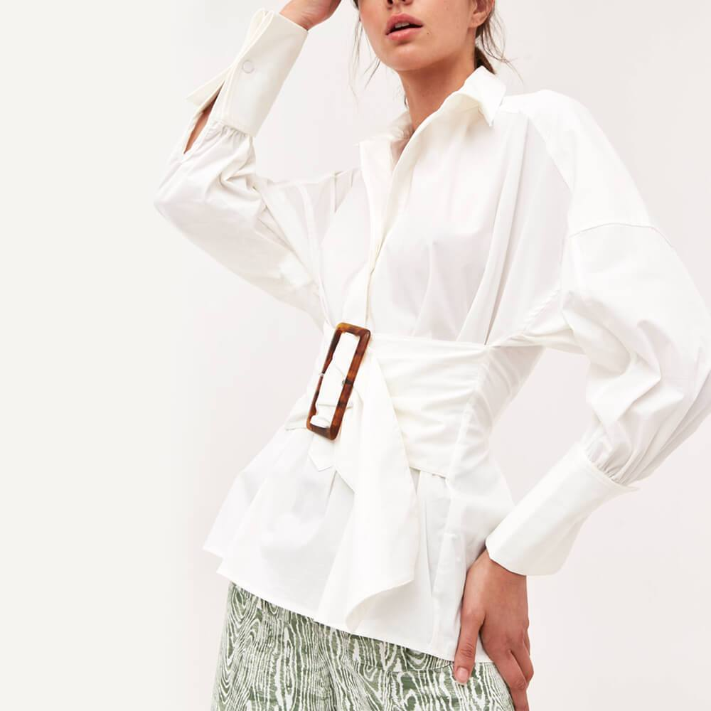 White fit and flare oversized shirt with dropped shoulders.