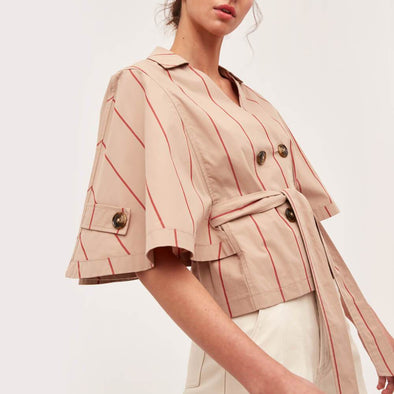 Beige relaxed fit top with fluted cape sleeves and red vertical stripes.