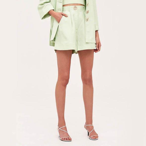 Pastel green wide leg shorts with front pockets and detachable tie.