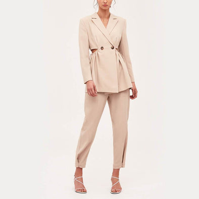 Beige relaxed fit tailored blazer featuring a waist cut-out with drawstring.