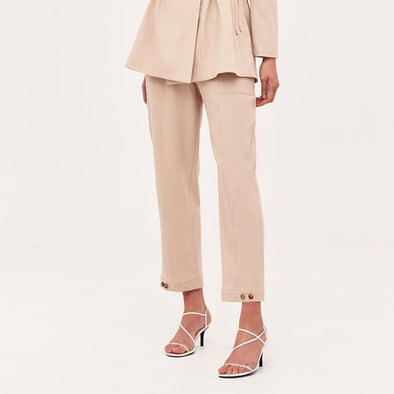 Beige straight fit trousers with patch pockets.