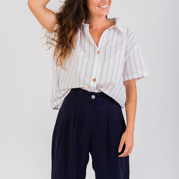 White striped straight-cut shirt with short sleeves.