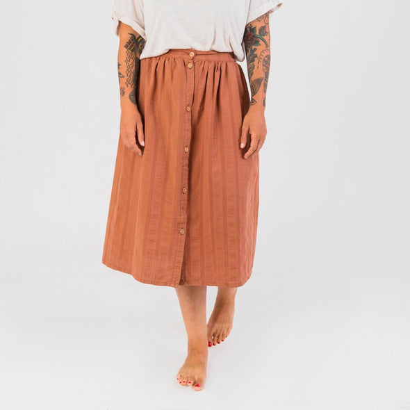 Rust flowy midi skirt with hidden side pockets.
