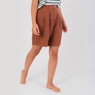 Terracotta high waisted shorts with side pockets and wide legs.