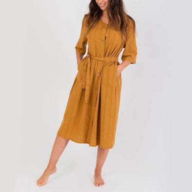 Slightly oversized mustard dress with a strap to tie at the waist.