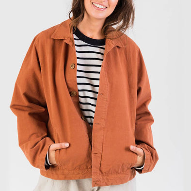 Terracotta canvas jacket with outside and inside pockets.