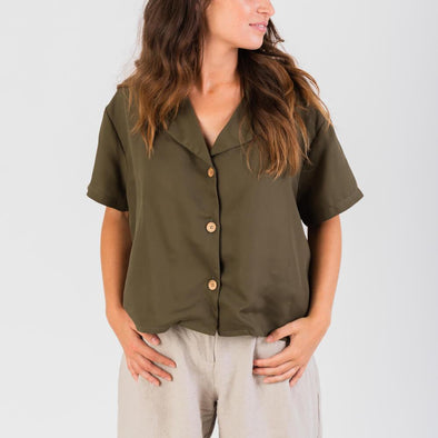 Khaki shirt with short sleeves and vintage inspired cleavage.