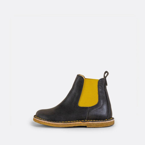 Kids' dark grey chelsea boots with yellow elastic and natural rubber sole.