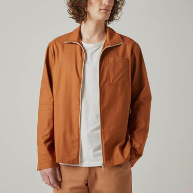 Dark orange zip up jacket.