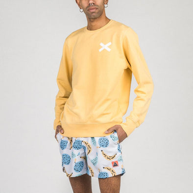 Soft yellow crewneck sweatshirt with white cross print.