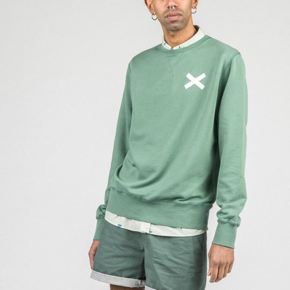 Green crewneck sweatshirt with white cross print.