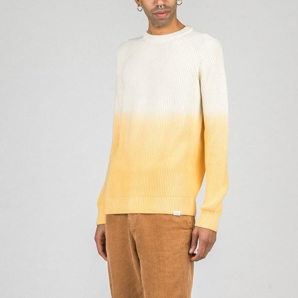 Relaxed fit knit sweater with yellow dip dye effect.