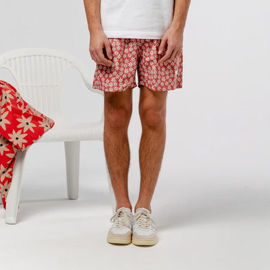 Red swim shorts flower print,with elastic waistband, cord fastening and back pockets.