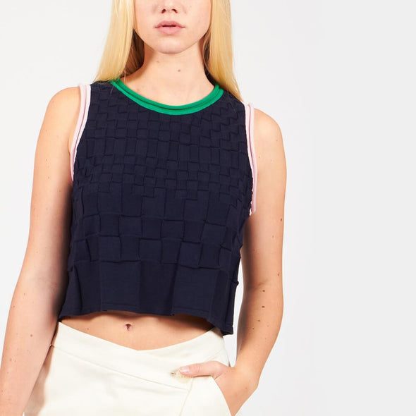 Navy blue sleveless crop-top with green and light pink details.