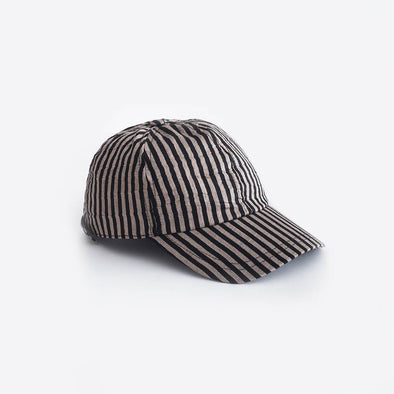 Black striped rounded baseball cap featuring an adjustable metal clip closure.