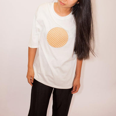 Super-soft oof-white oversized t-shirt with a front circle application.