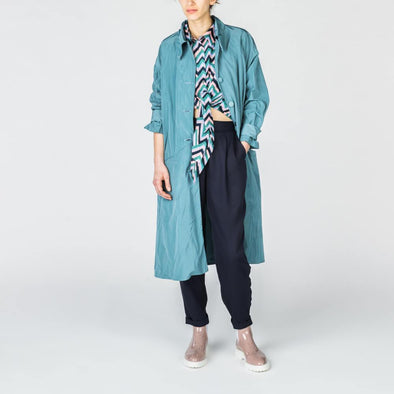 Blue-grey midi parka with pockets.