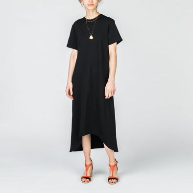 Black oversized dress with belt detail at the back.