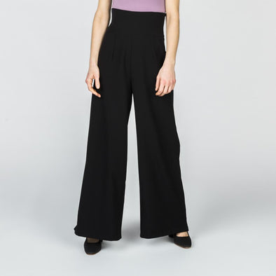 Black high-waisted palazzo pants.