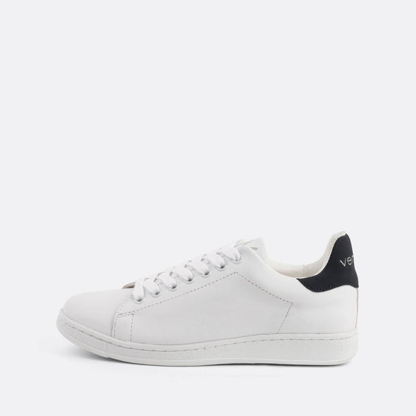"White low-top sneakers featuring the brand's signature ""V"" on the tongue and black heel tab."