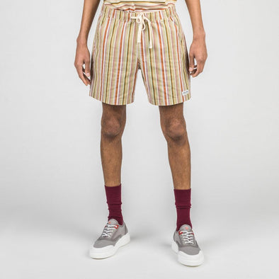 Multicolored board shorts with elastic waistband, side mesh pockets and back patch pocket.
