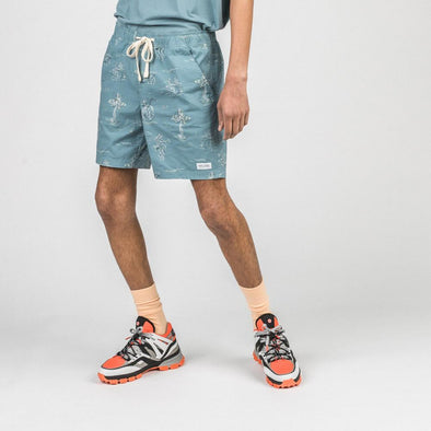 Blue board shorts with elastic waistband, side mesh pockets and back patch pocket.