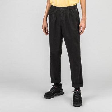 Black straight elastic fit pants with front pleats and back welt pockets.
