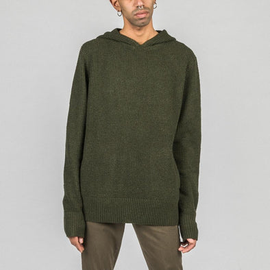 Olive green guage knit pullover with welt pockets and hoodie.