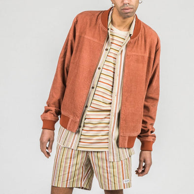 Rust bomber jacket with ribbed collar, hem and sleeve cuffs.