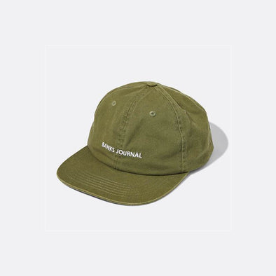 "Olive green hat with ""Banks Journal"" embroidery and snap back."