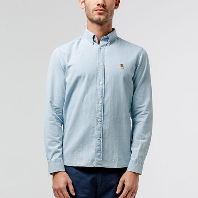 Light blue oxford button down shirt with a special edition duck patch on the chest.