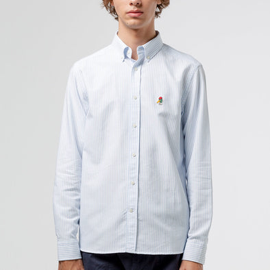 Light blue classic button down shirt with iconic duck patch on the chest.