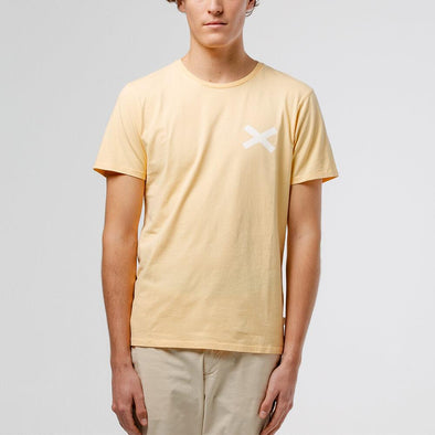Yellow t-shirt with white cross print on the chest.