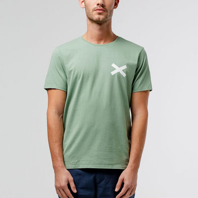 Green t-shirt with white cross print on the chest.