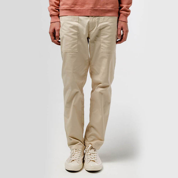 Beige workwear inspired pants with front and back pockets.