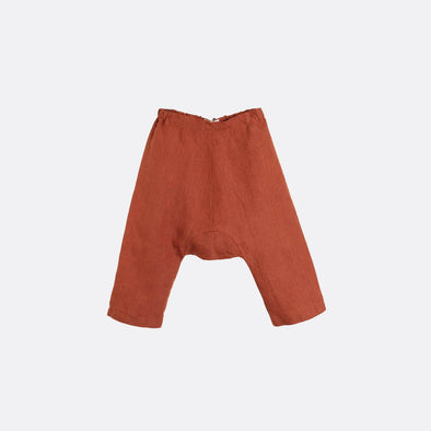 Rust elastic waist drop crotch trousers.