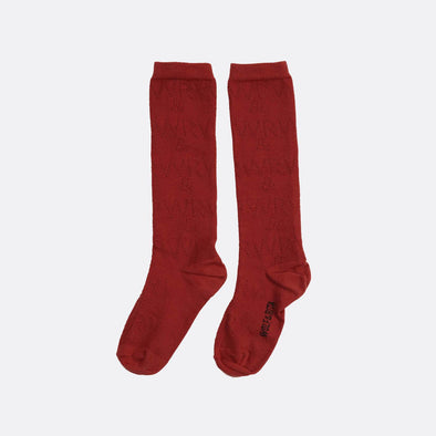 Long red socks with W&R perforated pattern.