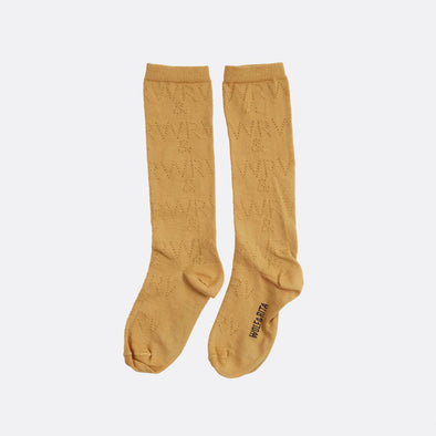Long yellow socks with W&R perforated pattern.
