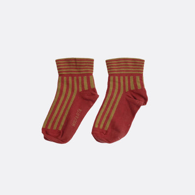 Red socks with contrasting stripes.