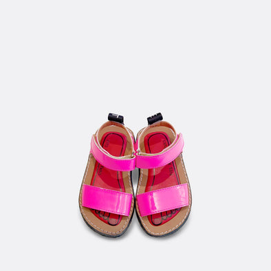Minimalist japanese inspired flat sandals in pop fluo pink leather.