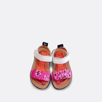 Japanese inspired flat sandals with a pink bandana wrapped around the upper.