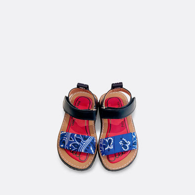 Japanese inspired flat sandals with a blue bandana wrapped around the upper.