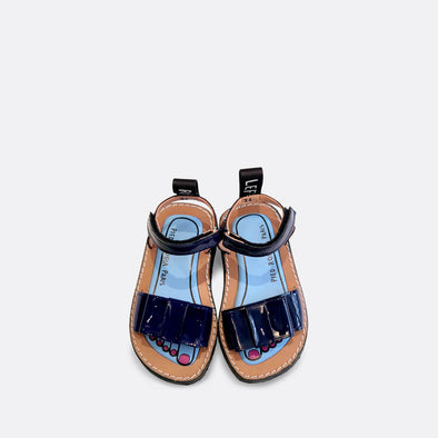 Kids' navy blue minimalist japanese inspired sandals with a flat bow.