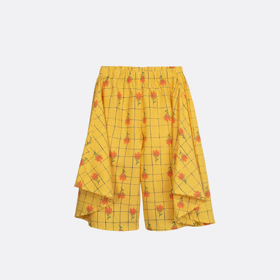 Yellow wide-leg pants with all-over flower print and elastic waistband.