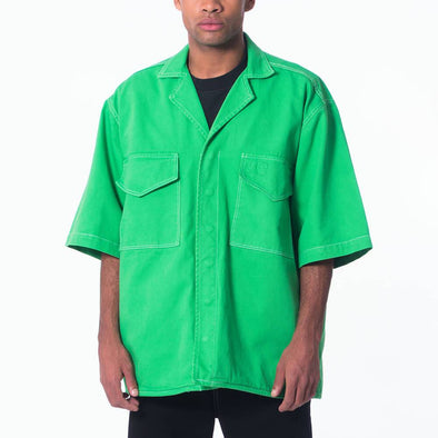 Straight line green boxy shirt with big pockets and embroidered logo.